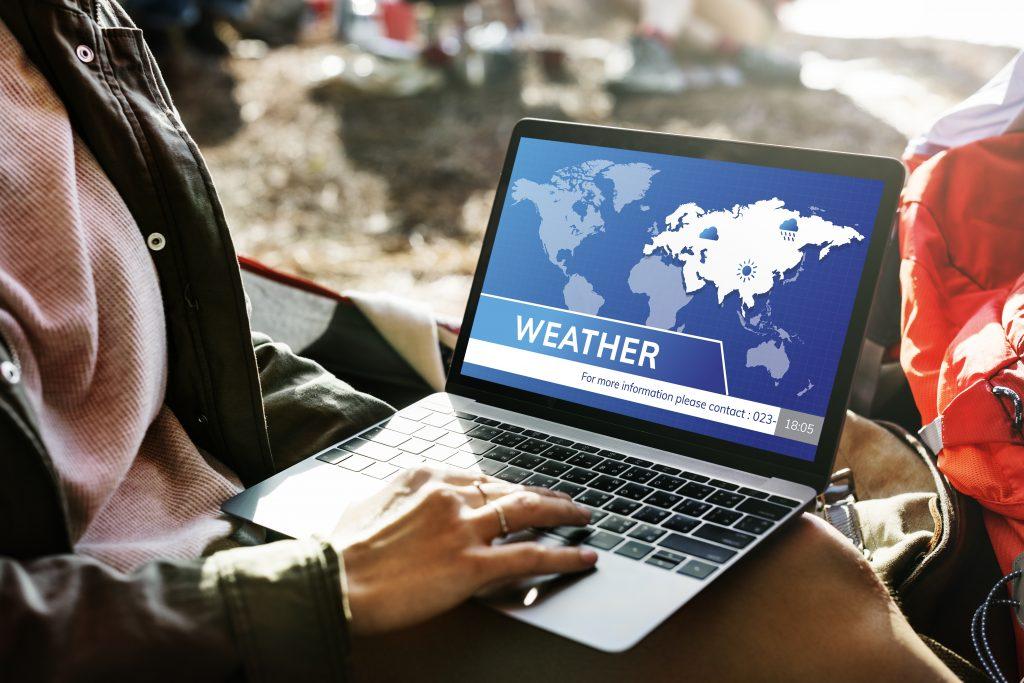 Digital weather news on laptop